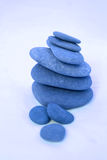 Blue Zen. Pile of stones in blue stock images