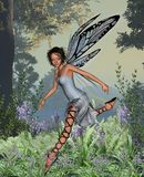 Bluebell Fairy. Digital render of a fairy dancing in a bluebell wood Royalty Free Stock Photo