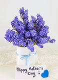 Bluebell flowers in vase and happy mothers day note Stock Images