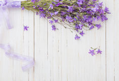 Bluebell flowers on  wooden background Stock Photo