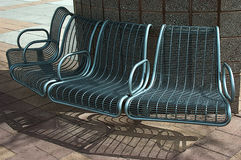 BlueBenches. Benches photographed at a bus stop site Royalty Free Stock Images
