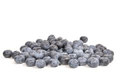 Blueberrie Pile. Large pile of blueberries isolated on white Stock Photos