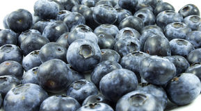 Blueberries. A handful of blueberries on a plate Royalty Free Stock Photo