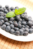 Blueberries. A plate of blueberries with mint leafs on top Stock Image