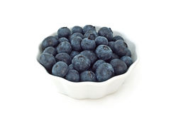Blueberries. In fluted white dish isolated on white background with copy space Stock Image