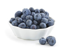 Blueberries. Fresh washed blueberries in small white dish Stock Photos