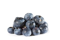 Blueberries. A pile of fresh organic blue berry. Side view on white background royalty free stock images