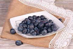 Blueberries. Fresh blueberries with mint leaves on a wooden background Royalty Free Stock Images