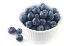 Blueberries. Bowl of blueberries, isolated on white.  Close-up view of this delicious berry fruit Stock Image