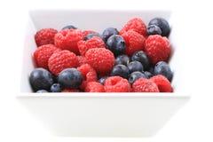 Blueberries ad raspberries Stock Photography