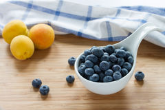 Blueberries and apricots Royalty Free Stock Photo