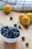 Blueberries and apricots Stock Photos