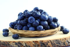 Blueberries in bamboo basket on white background Stock Images