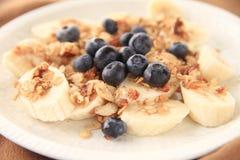 Blueberries, bananas and granola Stock Photos