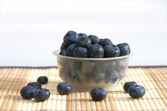 Blueberries in a basket. On bamboo serviette Royalty Free Stock Images