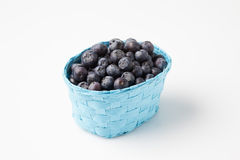 Blueberries in basket Stock Images