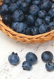 Blueberries in a basket on wooden table Royalty Free Stock Photography