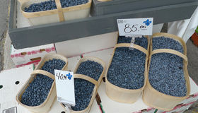 Blueberries in Baskets. Wooden baskets filled with blueberries at an outdoor farmers market Stock Photo