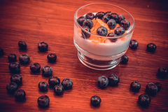 Blueberries on a bed of whipped cream. Useful yogurt with blueberries  cream Royalty Free Stock Images