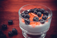 Blueberries on a bed of whipped cream. Useful yogurt with blueberries  cream Royalty Free Stock Photos