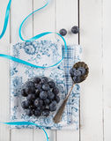 Blueberries or bilberries on a bowl and a spoon Royalty Free Stock Image