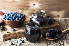 Blueberries and blackberries jam in glass jars Royalty Free Stock Photo