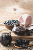 Blueberries and blackberries jam in glass jars Stock Photo