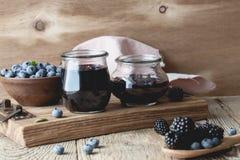 Blueberries and blackberries jam in glass jars Royalty Free Stock Image