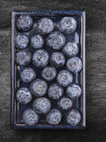 Blueberries on blue plate on gray old wooden table Stock Image