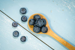 Blueberries on Blue Wood Background Stock Photography