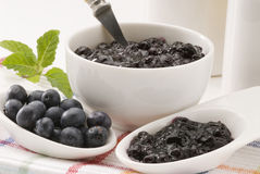 Blueberries and blueberry jam. Stock Photos