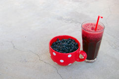 Blueberries and blueberry smoothie Royalty Free Stock Images