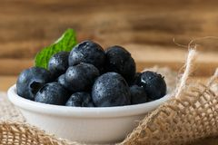 Blueberries in bowl above hession placemat. Blueberries fresh ready to eat placed on hessian placemat, perfect for a breakfast topping or for pancakes Royalty Free Stock Photography