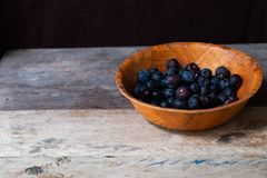 Blueberries in the bowl. On wooden table Royalty Free Stock Images