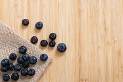 Blueberries in the bowl. On wooden table Royalty Free Stock Image
