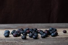 Blueberries in the bowl. On wooden table Stock Photo