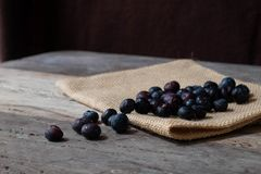 Blueberries in the bowl. On wooden table Stock Photography