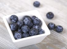 Blueberries in a bowl. Blueberry in the Cup on a gray background, fresh berries, dietary food Stock Photo
