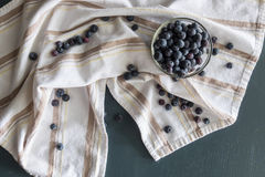 Blueberries in a bowl on a cotton cloth Royalty Free Stock Image