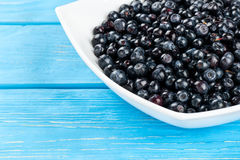 Blueberries in bowl. Some bowls of ripe blueberries on a table, close-up royalty free stock photography