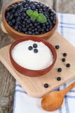 Blueberries in a bowl and sugar Royalty Free Stock Photography
