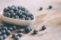 Blueberries in a bowl on table Royalty Free Stock Image