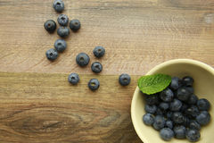 Blueberries in a bowl on a wooden background Royalty Free Stock Photos
