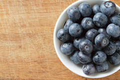 Blueberries in bowl on wooden. Blueberry contain antioxidant organic  useful healthy and nutrition. Stock Photography