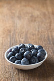 Blueberries in bowl on wooden. Blueberry contain antioxidant organic  useful healthy and nutrition. Stock Image