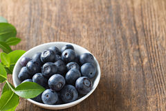 Blueberries in bowl on wooden. Blueberry contain antioxidant organic  useful healthy and nutrition. Stock Images