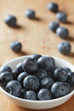 Blueberries in bowl on wooden. Blueberry contain antioxidant organic  useful healthy and nutrition. Royalty Free Stock Image