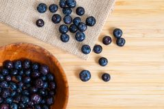 Blueberries in the bowl. On wooden table Stock Image