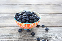 Blueberries in a bowl on wooden table Stock Image