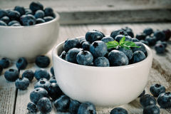 Blueberries in bowls. Close-up of blueberries in two bowls standing on a  wooden table Stock Images